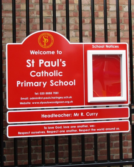 a school noticeboard on railings at St Pauls Catholic Primary School