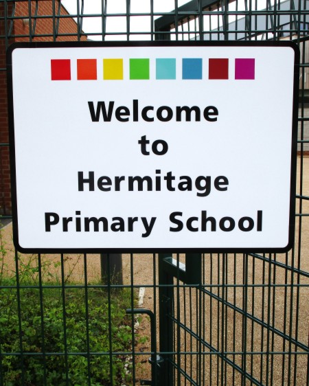 school sign on a fence at Hermitage Primary School